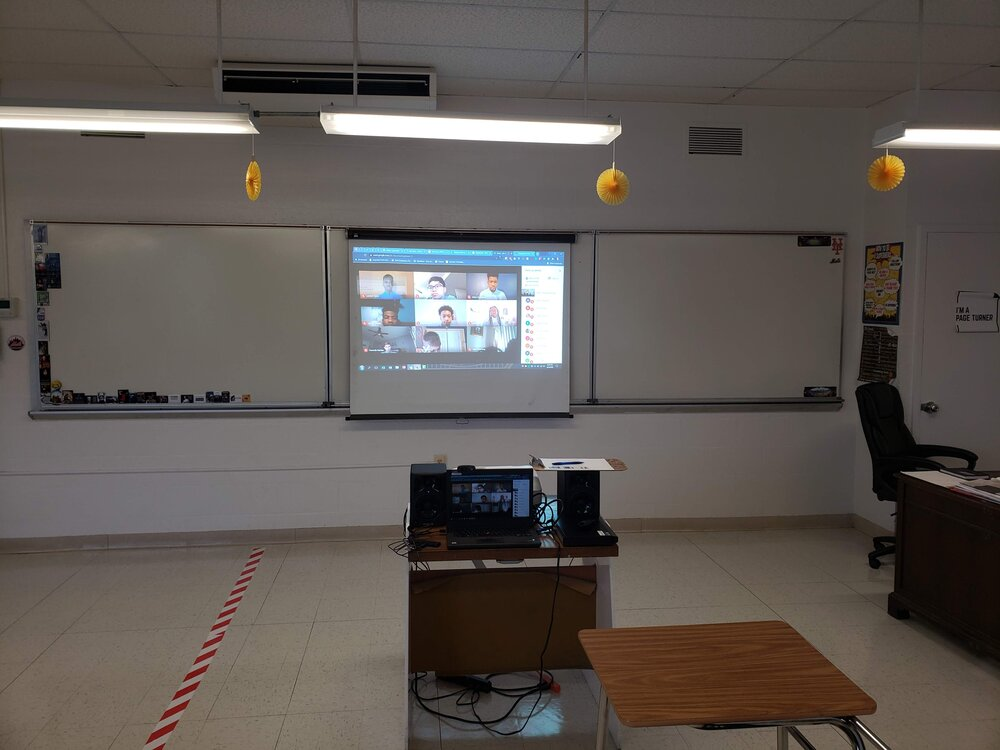 Here's how the in-class students see the online students. My desk got moved upfront to create more socially distant desk spaces for the students.