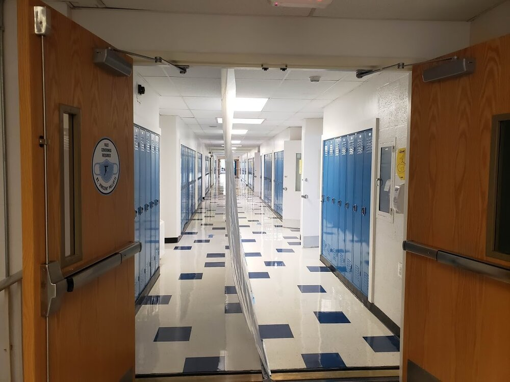 My hallway with heavy plastic sheeting to shield students as they shuffle following directional arrows.