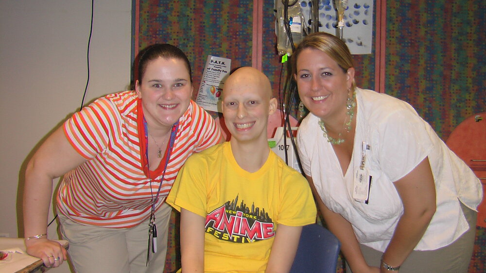 Robbie with Kendra and Mary, two of the people ensuring he was kept busy and active while being treated.